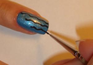 Нанесите желаемый рисунок акриловыми красками на ногти